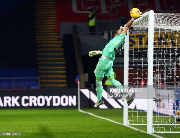 Crystal Palace's Spanish goalkeeper Vicente Guaita makes a save during the English Premier League football match between Crystal Palace and Tottenham...