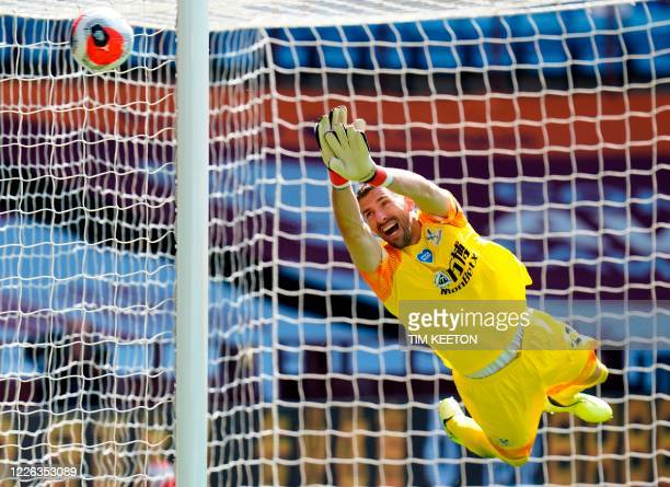 Crystal Palace's Spanish goalkeeper Vicente Guaita makes a save on a free kick during the English Premier League football match between Aston Villa...