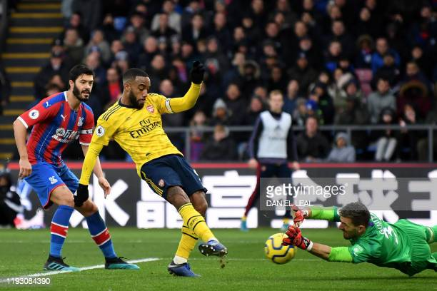 Crystal Palace's Spanish goalkeeper Vicente Guaita saves an attempt by Arsenal's French striker Alexandre Lacazette during the English Premier League...