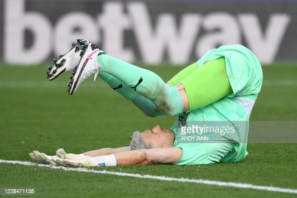 Crystal Palace's Spanish goalkeeper Vicente Guaita stretches during a break in play during the English Premier League football match between Crystal...