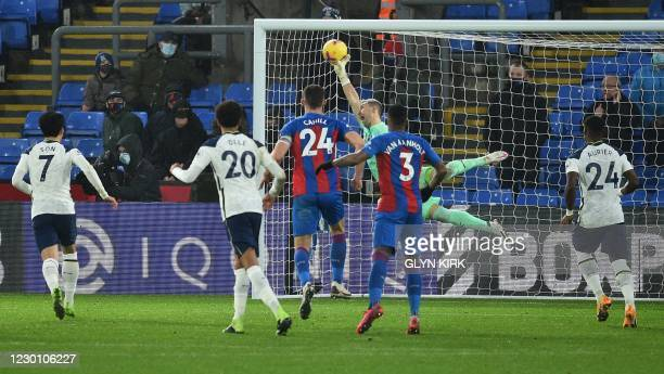 Crystal Palace's Spanish goalkeeper Vicente Guaita tips the ball over the bar to make a save from a free kick by Tottenham Hotspur's English defender...