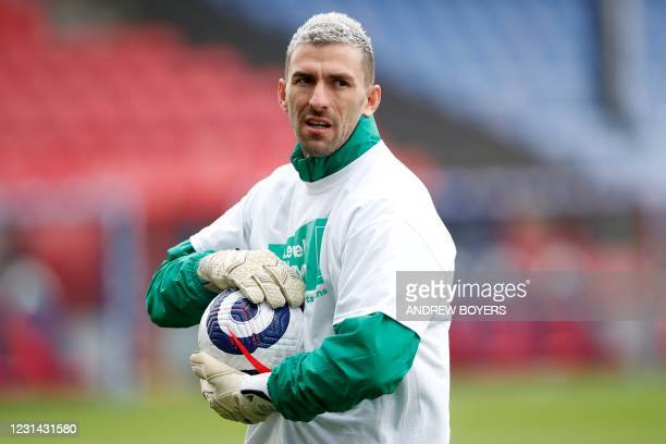 Crystal Palace's Spanish goalkeeper Vicente Guaita warm up ahead of the English Premier League football match between Crystal Palace and Fulham at...