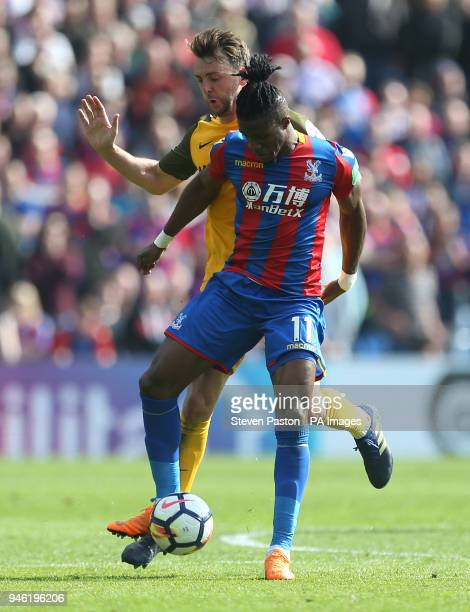 Crystal Palace's Wilfried Zaha and Brighton Hove Albion's Dale Stephens battle for the ball during the Premier League match at Selhurst Park London