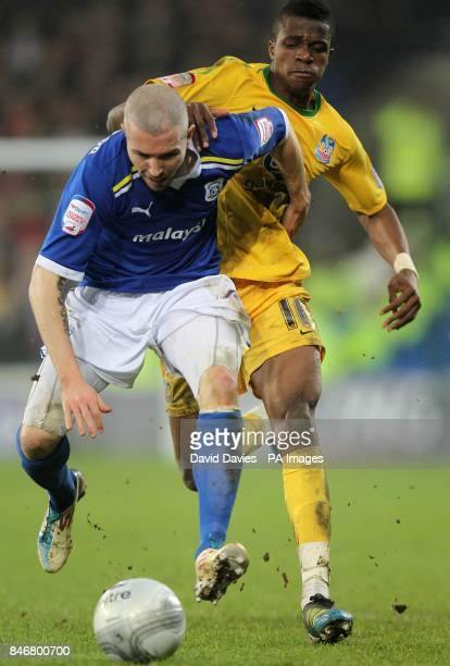 Crystal Palace's Wilfried Zaha and Cardiff City's Kevin McNaughton battle for the ball