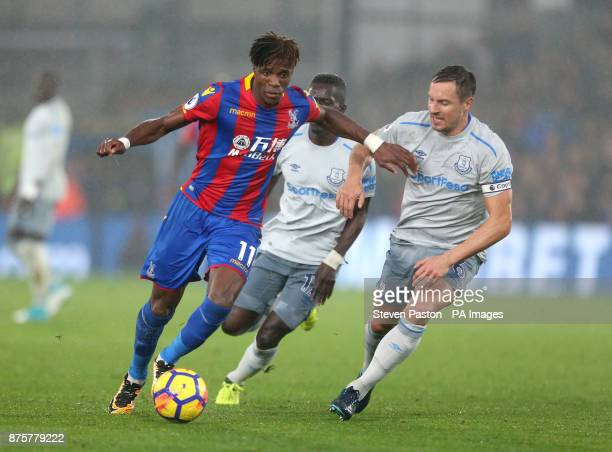 Crystal Palace's Wilfried Zaha and Everton's Phil Jagielka battle for the ball during the Premier League match at Selhurst Park London