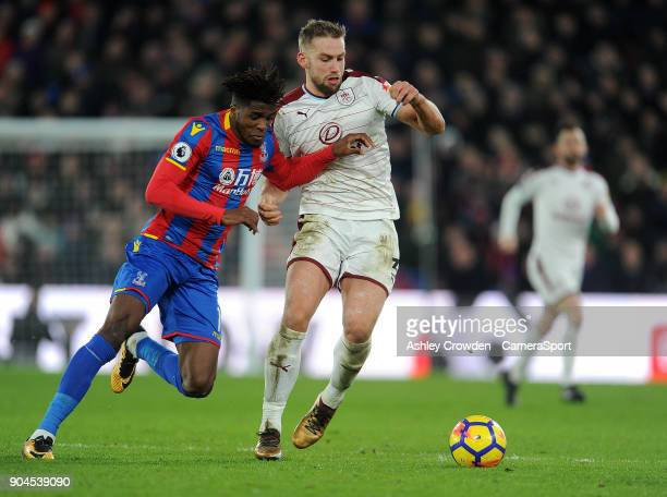 Crystal Palace's Wilfried Zaha battles with Burnley's Charlie Taylor during the Premier League match between Crystal Palace and Burnley at Selhurst...