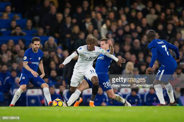 Crystal Palace's Wilfried Zaha holds off the challenge from Chelsea's Cesar Azpilicueta during the Premier League match between Chelsea and Crystal...
