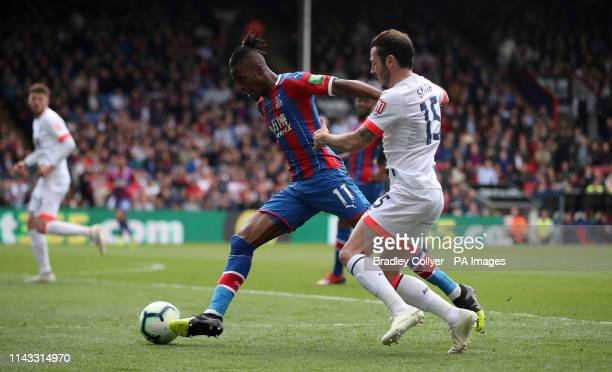 Crystal Palace's Wilfried Zaha in action with Bournemouth's Adam Smith during the Premier League match at Selhurst Park London