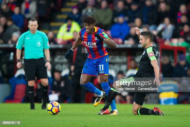 Crystal Palace's Wilfried Zaha is fouled by Bournemouth's Andrew Surman during the Premier League match between Crystal Palace and AFC Bournemouth at...