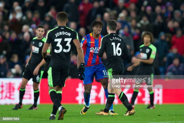 Crystal Palace's Wilfried Zaha reacts angrily to a challenge by Bournemouth's Lewis Cook during the Premier League match between Crystal Palace and...