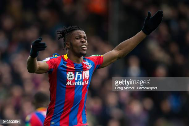 Crystal Palace's Wilfried Zaha reacts to a missed chance from team mate Crystal Palace's Christian Benteke during the Premier League match between...