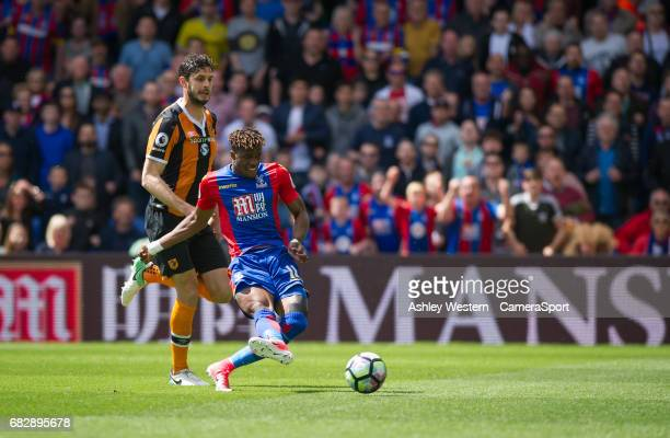 Crystal Palace's Wilfried Zaha scores the opening goal during the Premier League match between Crystal Palace and Hull City at Selhurst Park on May...