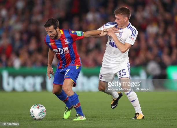 Crystal Palace's Yohan Cabaye and Ipswich Town's Ben Morris battle for the ball during the Carabao Cup Second Round match at Selhurst Park London