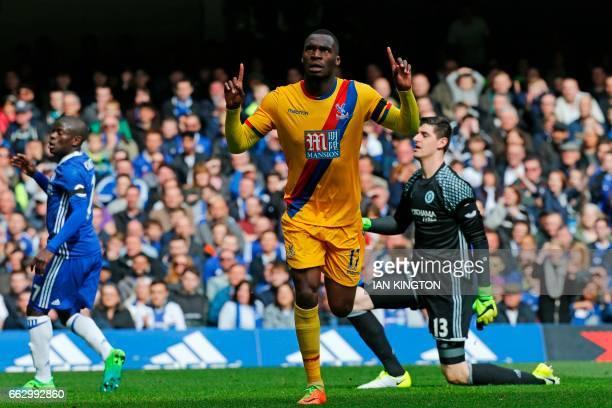 Crystal Palace's Zaireborn Belgian striker Christian Benteke celebrates after scoring their second goal during the English Premier League football...
