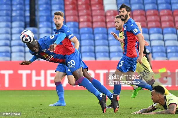 Crystal Palace's Zaire-born Belgian striker Christian Benteke dives to head home their first goal during the English Premier League football match...