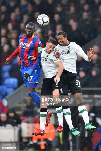 Crystal Palace's Zaireborn Belgian striker Christian Benteke Liverpool's English midfielder Jordan Henderson and Liverpool's Germanborn Cameroonian...
