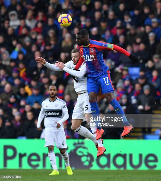 Crystal Palace's Zaireborn Belgian striker Christian Benteke goes up for a header against Fulham's English defender Calum Chambers during the English...