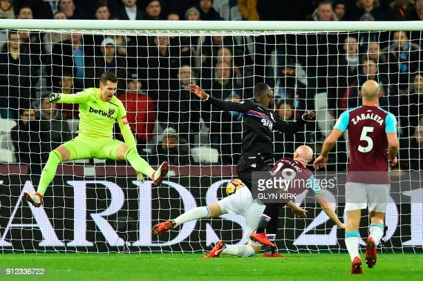 Crystal Palace's Zaireborn Belgian striker Christian Benteke heads the ball to score the opening goal during the English Premier League football...