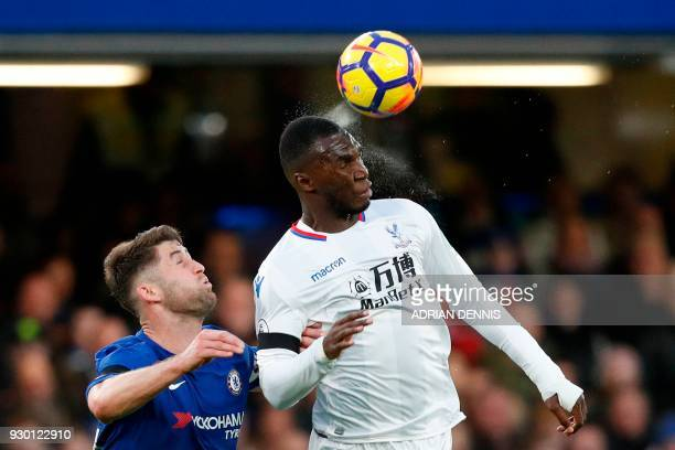 Crystal Palace's Zaireborn Belgian striker Christian Benteke heads the ball during the English Premier League football match between Chelsea and...