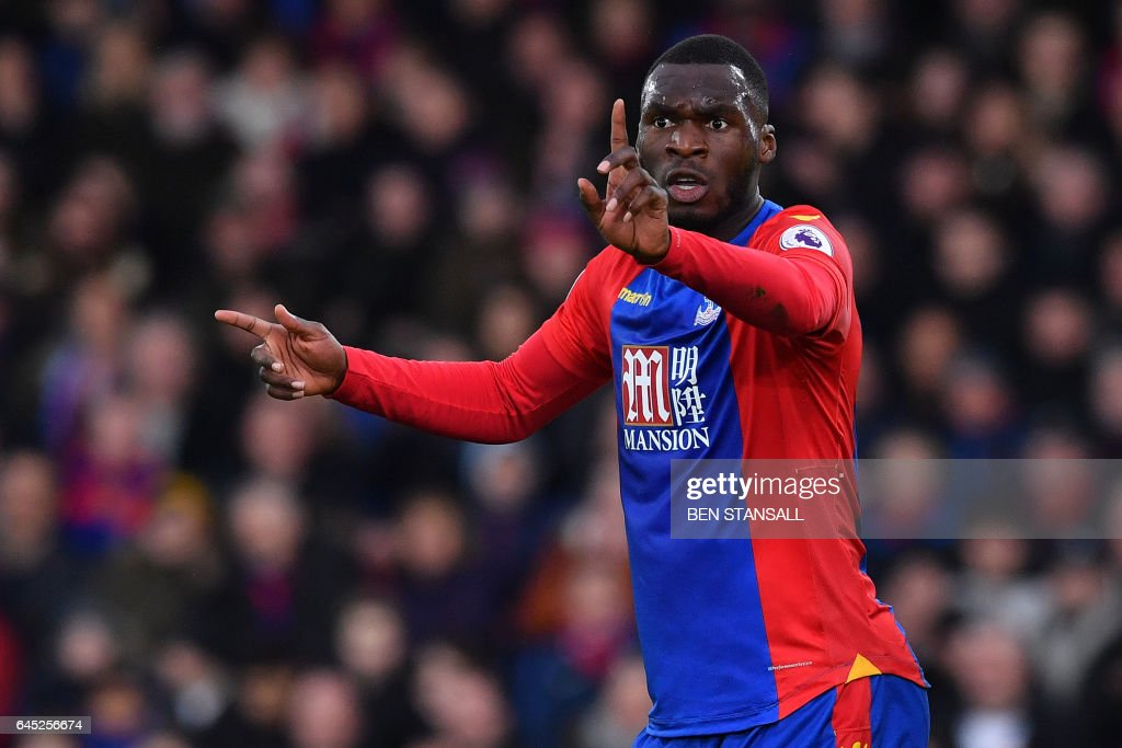 Crystal Palace's Zaire-born Belgian striker Christian Benteke reacts after being called offside by the linesman during the English Premier League football match between Crystal Palace and Middlesbrough at Selhurst Park in south London on February 25, 2017. / AFP PHOTO / Ben STANSALL / RESTRICTED TO EDITORIAL USE. No use with unauthorized audio, video, data, fixture lists, club/league logos or 'live' services. Online in-match use limited to 75 images, no video emulation. No use in betting, games or single club/league/player publications. /