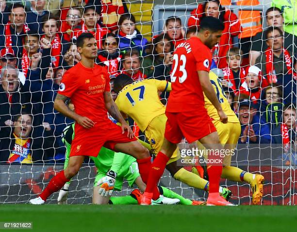 Crystal Palace's Zaireborn Belgian striker Christian Benteke scores past Liverpool's Belgian goalkeeper Simon Mignolet during the English Premier...