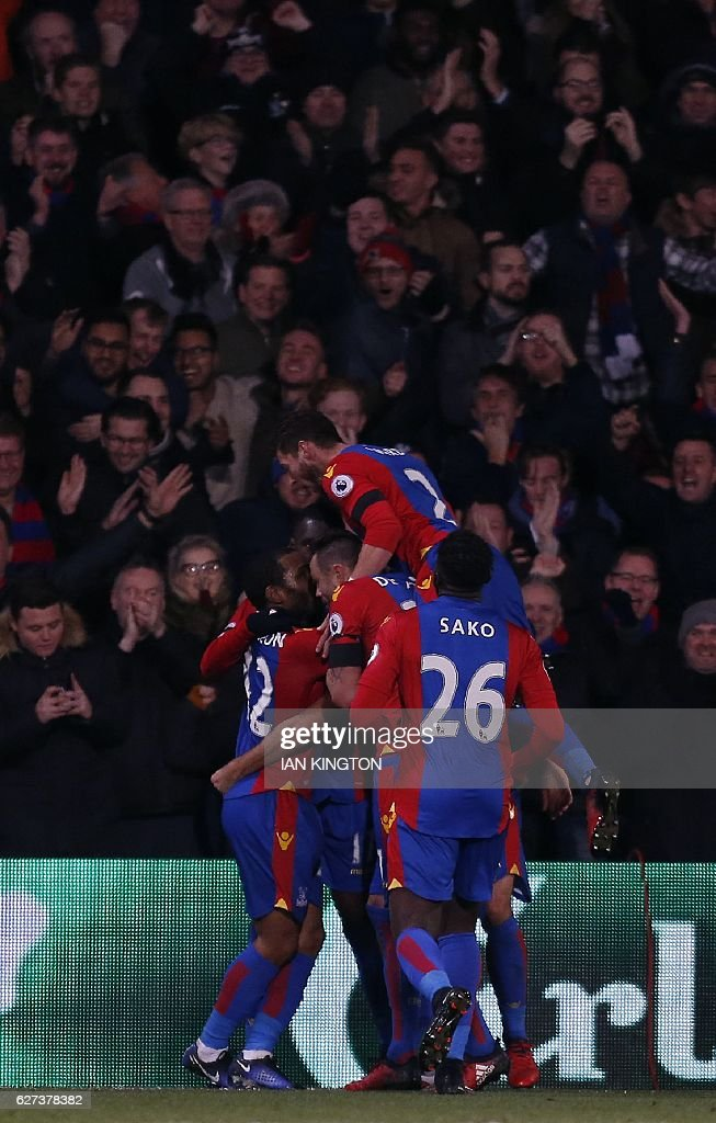 Crystal Palace's Zaire-born Belgian striker Christian Benteke celebrates scoring his team's third goal during the English Premier League football match between Crystal Palace and Southampton at Selhurst Park in south London on December 3, 2016. / AFP / Ian KINGTON / RESTRICTED TO EDITORIAL USE. No use with unauthorized audio, video, data, fixture lists, club/league logos or 'live' services. Online in-match use limited to 75 images, no video emulation. No use in betting, games or single club/league/player publications. /