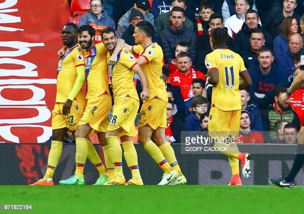 Crystal Palace's Zaireborn Belgian striker Christian Benteke celebrates scoring a goal with Crystal Palace's English defender James Tomkins and...