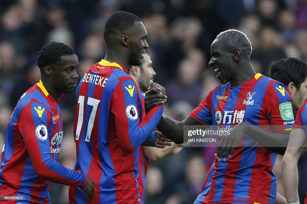 Crystal Palace's Zaire-born Belgian striker Christian Benteke (C) celebrates scoring a penalty during the English Premier League football match between Crystal Palace and Leicester City at Selhurst Park in south London on April 28, 2018. (Photo by Ian KINGTON / AFP) / RESTRICTED TO EDITORIAL USE. No use with unauthorized audio, video, data, fixture lists, club/league logos or 'live' services. Online in-match use limited to 75 images, no video emulation. No use in betting, games or single club/league/player publications. /