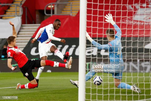Crystal Palace's Zaire-born Belgian striker Christian Benteke shoots past Southampton's English goalkeeper Fraser Forster to score the opening goal...