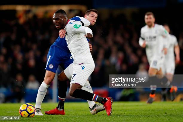 Crystal Palace's Zaireborn Belgian striker Christian Benteke tangles with Chelsea's Spanish defender Cesar Azpilicueta during the English Premier...