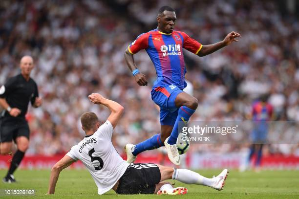Crystal Palace's Zaireborn Belgian striker Christian Benteke vies with Fulham's English defender Calum Chambers during the English Premier League...