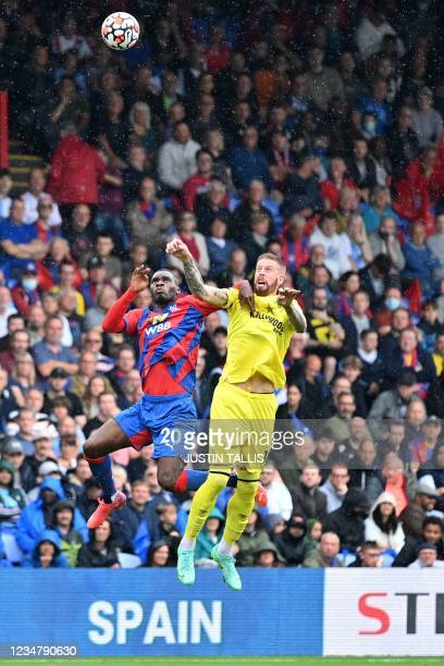 Crystal Palace's Zaire-born Belgian striker Christian Benteke vies with Brentford's Swedish defender Pontus Jansson during the English Premier League...