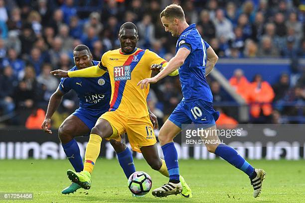 Crystal Palace's Zaireborn Belgian striker Christian Benteke vies with Leicester City's Welsh midfielder Andy King during the English Premier League...