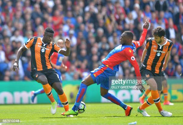Crystal Palace's Zaireborn Belgian striker Christian Benteke vies with Hull City's French midfielder Alfred N'Diaye during the English Premier League...