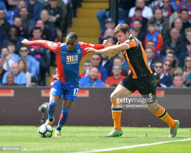Crystal Palace's Zaireborn Belgian striker Christian Benteke vies with Hull City's English defender Harry Maguire during the English Premier League...