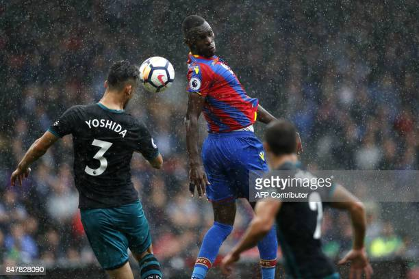 TOPSHOT Crystal Palace's Zaireborn Belgian striker Christian Benteke vies with Southampton's Japanese defender Maya Yoshida during the English...
