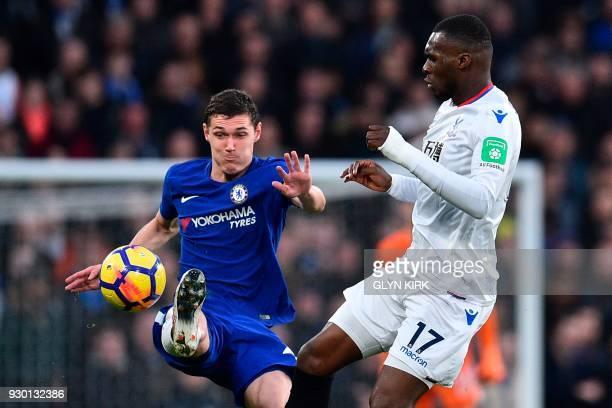 Crystal Palace's Zaireborn Belgian striker Christian Benteke vies with Chelsea's Danish defender Andreas Christensen during the English Premier...