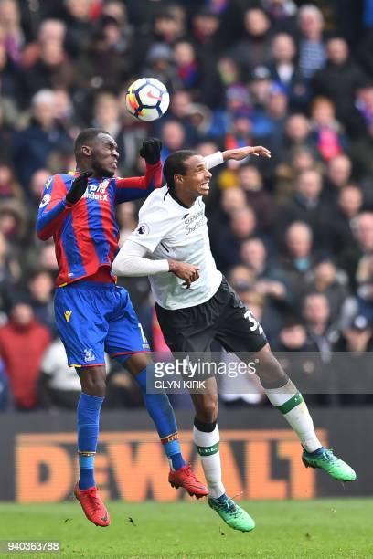 Crystal Palace's Zaireborn Belgian striker Christian Benteke vies with Liverpool's Germanborn Cameroonian defender Joel Matip during the English...