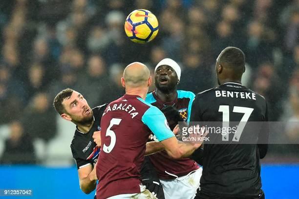 Crystal Palace's Zaireborn Belgian striker Christian Benteke West Ham United's Senegalese midfielder Cheikhou Kouyate West Ham United's Argentinian...