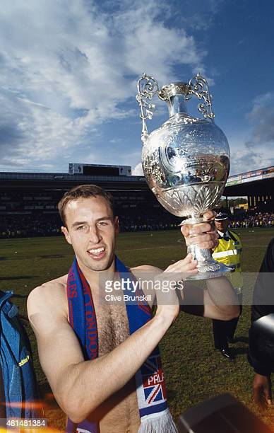 Crystal Palce defender Gareth Southgate pictured with the League Championship trophy after the Division One match between Crystal Palace and Watford...
