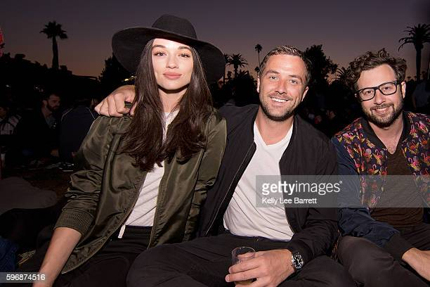 Crystal Reed and friends attend Cinespia's screening of 'Poltergeist' held at Hollywood Forever on August 27 2016 in Hollywood California