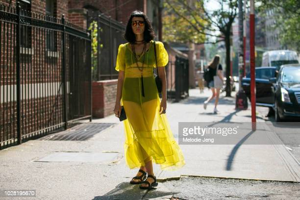 Crystal Renn wears a yellow outfit outside the Collina Strada show on Day 1 of New York Fashion Week Spring/Summer 2019 on September 6 2018 in New...