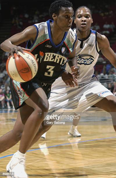 Crystal Robinson of the New York Liberty drives past Elaine Powell of the Orlando Miracle in the game on June 23 2002 at TD Waterhouse Centre in...