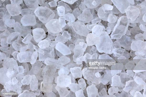 crystal rock salt for road de-icing - road salt stock pictures, royalty-free photos & images