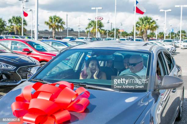 Crystal Rogers tears up with her husband Henry Rogers after he received a 2018 Hyundai Elantra September 25 2017 in Baytown Texas Henry Rogers was...