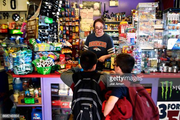 Crystal Sanchez waits on children on their way home from school at the StopNStop food store near the I70 viaduct The Sanchez family has run their...