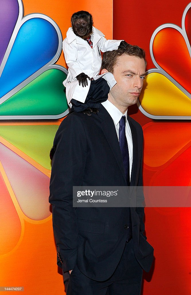 Crystal the Monkey and actor Justin Kirk attend NBC's Upfront Presentation at Radio City Music Hall on May 14, 2012 in New York City.