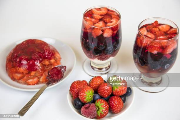 Crystal, transparent Jello dessert with strawberries, blueberries and raspberries, homemade dessert