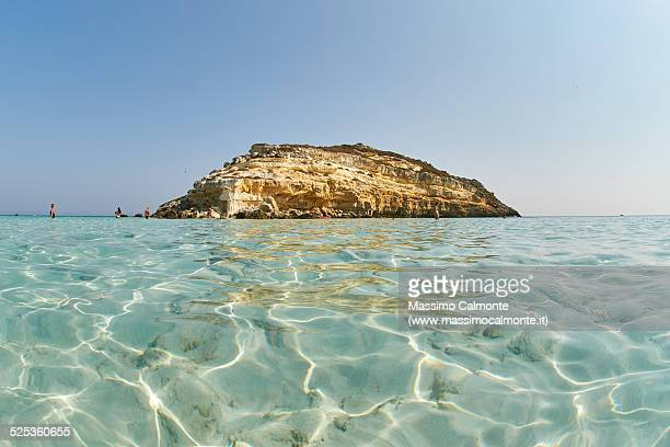 crystal water and isola dei conigli in lampedusa - lampedusa stock pictures, royalty-free photos & images