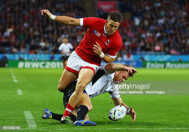 Csaba Gal of Romania and DTH Van Der Merwe of Canada scramble for the ball during the 2015 Rugby World Cup Pool D match between Canada and Romania at...